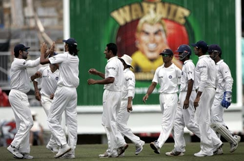 Indian teammates celebrate the wicket of Phil Jaques at the Sydney Cricket Ground on Saturday, January 5, 2008, on the fourth day of their second cricket Test. India made 532 in reply to Australia's 463 in their first innings.