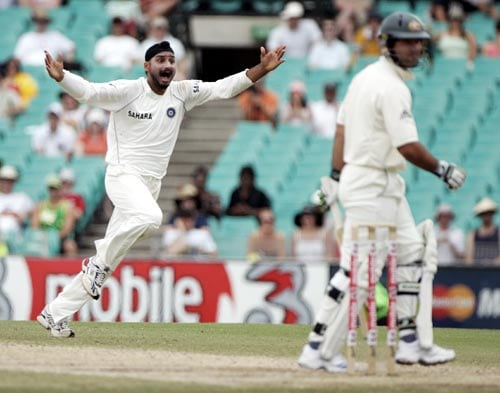 Harbhajan Singh, left, celebrates taking the wicket of Ricky Ponting, right, for 1 run at the Sydney Cricket Ground on Saturday, January 5, 2008, on the fourth day of their second cricket Test.