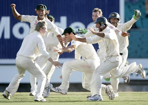 Australian team-mates celebrate their victory over India at the Sydney Cricket Ground on Sunday, January 6, 2008, on the last day of their second cricket Test. Australia won the Test to equal the world record of 16 consecutive Tests.
