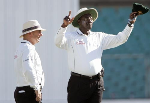 Mark Benson, left, and Steve Bucknor request a third umpire decision at the Sydney Cricket Ground on Sunday, January 6, 2008, on the last day of their second cricket Test Between Australia and India. The umpires have come under criticism for bad decisions throughout the match.