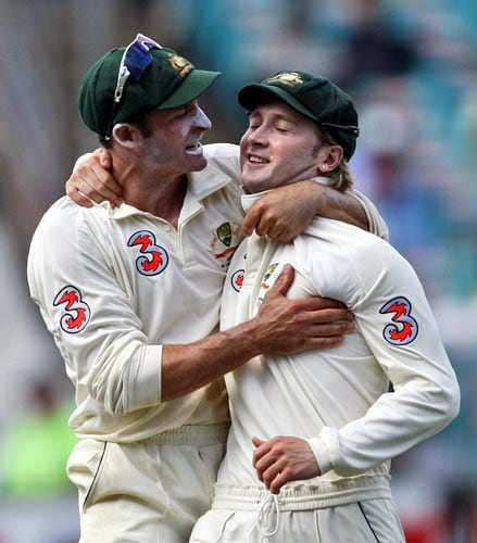 Michael Hussey, left, celebrates Michael Clarke celebrates after the wickets of Sourav Ganguly on the last day of the second Test in Sydney on Sunday, January 6, 2008. Ganguly was caught out by Clarke for 51 runs with India chasing a score of 330 runs.