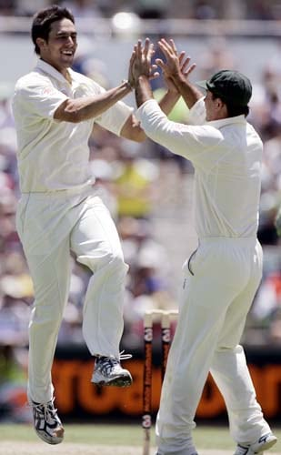 Ricky Ponting, right, celebrates with Mitchell Johnson who took the wicket of Virender Sehwag for 29 runs at the WACA in Perth on Wednesday, January 16, 2008, on the first day of their third Test match. Australia lead the series 2-0.