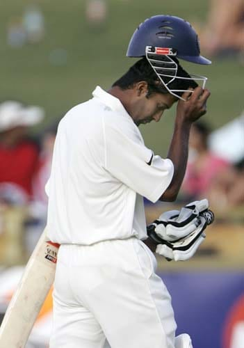 Wasim Jaffer removes his helmet as he walks off after he was caught out for 11 runs against Australia at the WACA in Perth on Thursday, January 17, 2008, on the second day of their third Test match. Australia made 212 in reply to India's 330 in their first innings.