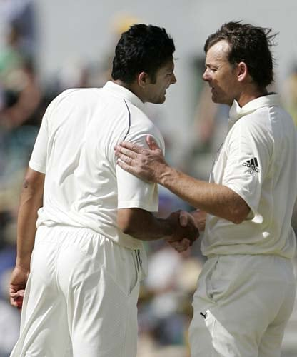 Anil Kumble, left, is congratulated by Australia's batsman Adam Gilchrist after taking his 600th Test wicket, that of Australia's Andrew Symonds at the WACA in Perth on Thursday, January 17, 2008, on the second day of their third Test match. India made 330 in their first innings.
