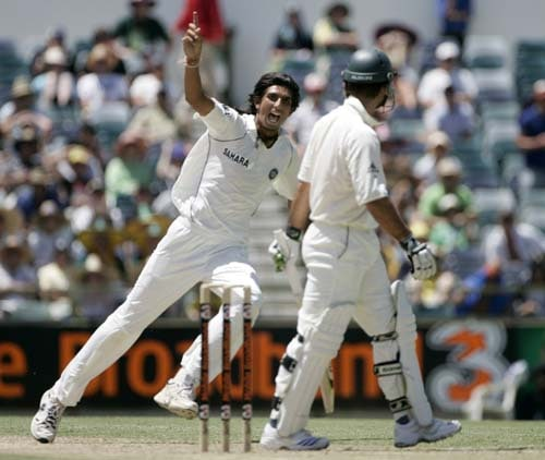 Ishant Sharma, left, celebrates taking the wicket of Australia's captain Ricky Ponting, right, for 20 runs at the WACA in Perth on Thursday, January 17, 2008, on the second day of their third Test match. India made 330 in their first innings.