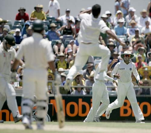 Irfan Pathan, center, jumps up after teammate VVS Laxman, right, caught out Australia's Phil Jaques for 8 runs at the WACA in Perth on Thursday, January 17, 2008, on the second day of their third Test match. India made 330 in their first innings.