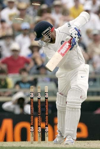 Virender Sehwag turns to see the bail fly after he was bowled by Stuart Clark for 43 runs at the WACA in Perth on Friday, January 18, 2008, on the third day of their third Test match.