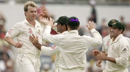 Brett Lee, left, celebrates with teammates after dismissing Rahul Dravid for 3 runs at the WACA in Perth on Friday, January 18, 2008, on the third day of their third Test match.