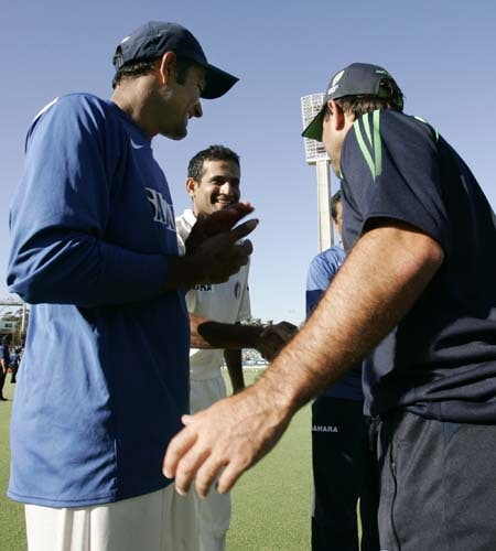 Australia's captain Ricky Ponting, right, congratulates India's captain Anil Kumble, left, and Irfan Pathan after their win at the WACA in Perth on Saturday, January 19, 2008, on the fourth day of their third Test match. India won the match by 72 runs and ended Australia's run of 16 consecutive Test victories.
