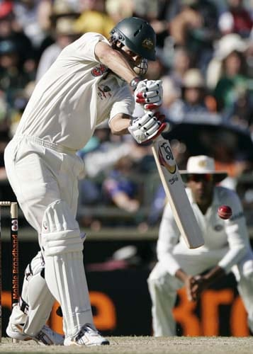 Mitchell Johnson drives the ball against India at the WACA in Perth on Saturday, January 19, 2008, on the fourth day of their third Test match.