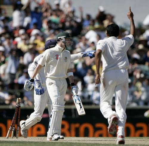 Michael Clarke, center, is stumped off the bowling of India's Anil Kumble, right, at the WACA in Perth on Saturday, January 19, 2008, on the fourth day of their third Test match.