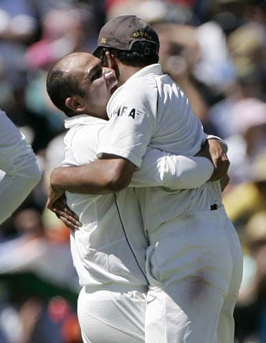 Virender Sehwag, right, embraces his team captain Anil Kumble after Sehwag took the wicket of Brett Lee for no score at the WACA in Perth on Saturday, January 19, 2008, on the fourth day of their third Test match
