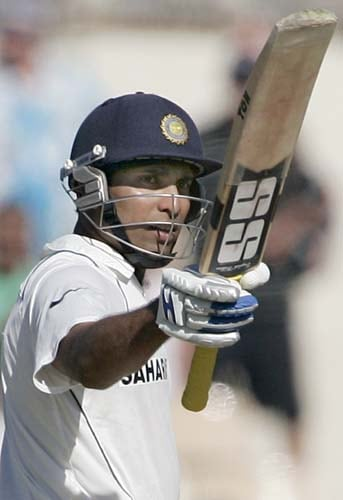 VVS Laxman raises his bat after making 50 runs against Australia at the Adelaide Oval on Thursday, January 24, 2008, on the first day of their fourth Test. Australia leads the series 2-1.