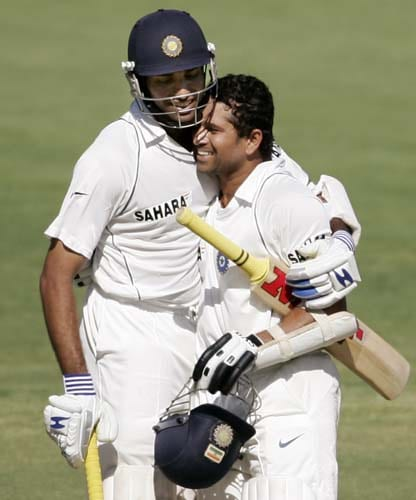 Sachin Tendulkar, right, is embraced by team-mate VVS Laxman as they celebrate Tendulkar making 100 runs against Australia at the Adelaide Oval on Thursday, January 24, 2008, on the first day of their fourth Test. Australia leads the series 2-1.