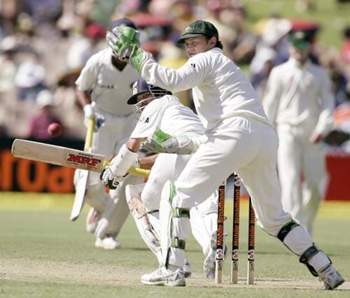 Sachin Tendulkar, left, sweeps past Australia's wicketkeeper Adam Gilchrist at the Adelaide Oval, in Australia, Thursday, Jan. 24, 2008, on the first day of their fourth Test. Australia leads the series 2-1.