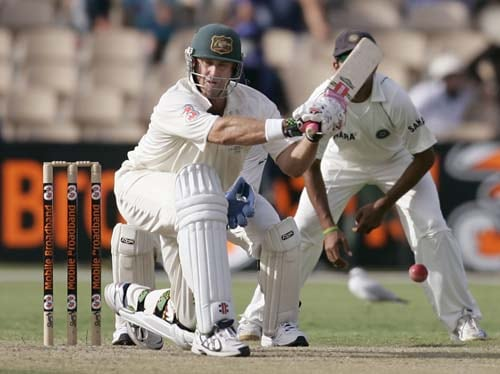 Matthew Hayden prepares to sweep against India at the Adelaide Oval on Friday, January 25, 2008, on the second day of their fourth Test. At stumps Australia are 62 for no loss in reply to India's first innings of 526.
