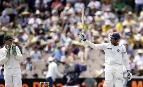 India's captain Anil Kumble, right, raises his bat after making 50 runs against Australia as wicketkeeper Adam Gilchrist applauds at the Adelaide Oval on Friday, January 25, 2008, on the second day of their fourth Test. India made 526 in their first innings.