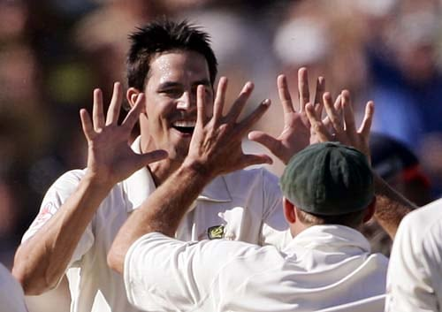 Mitchell Johnson celebrates with team-mates after taking the wicket of opening batsman Irfan Pathan at the Adelaide Oval on Sunday, January 27, 2008, on the fourth day of their fourth Test. Australia made 563 in reply to India's first innings total of 526.