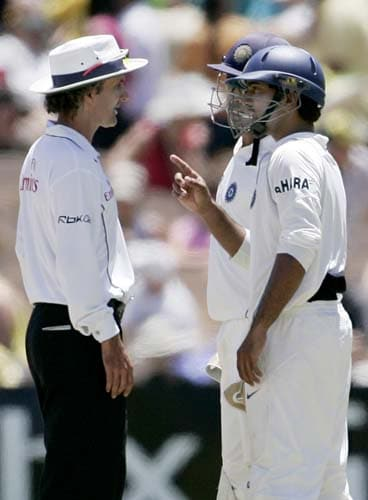 Dinesh Karthik, front right, and Mahendra Dhoni have a word with umpire Billy Bowden between overs during play against Australia at the Adelaide Oval on Sunday, January 27, 2008, on the fourth day of their fourth Test. India made a first innings total of 526.