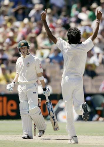 Ishant Sharma, right, celebrate taking the wicket of Michael Clarke, left, for 118 runs at the Adelaide Oval on Sunday, January 27, 2008, on the fourth day of their fourth Test. India made a first innings total of 526.
