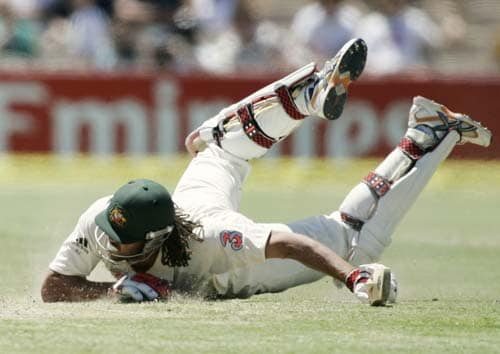 Andrew Symonds dives to make his ground against India at the Adelaide Oval on Sunday, January 27, 2008, on the fourth day of their fourth Test. India made a first innings total of 526.