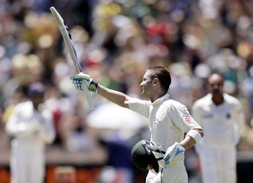 Michael Clarke raises his bat after making 100 runs against India at the Adelaide Oval on Sunday, January 27, 2008, on the fourth day of their fourth Test. India made a first innings total of 526.