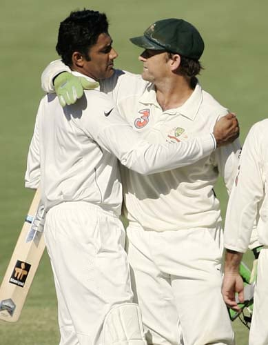 Anil Kumble, left, embraces Australia's retiring wicketkeeper Adam Gilchrist at the end of their fourth Test match at the Adelaide Oval on Monday, January 28, 2008. The match was drawn while the series went to Australia 2-1.