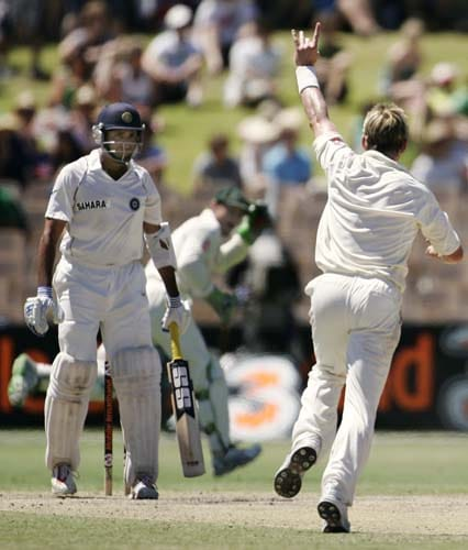 Australia's wicketkeeper Adam Gilchrist, center, catches out Indai's VVS Laxman, left, off Brett Lee, right, at the Adelaide Oval on Monday, January 28, 2008, on the last day of their fourth Test.