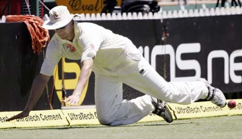 Stuart Clark stretches out to save a boundary against India at the Adelaide Oval on Monday, January 28, 2008, on the last day of their fourth Test. Australia made 563 in reply to India's first innings total of 526.