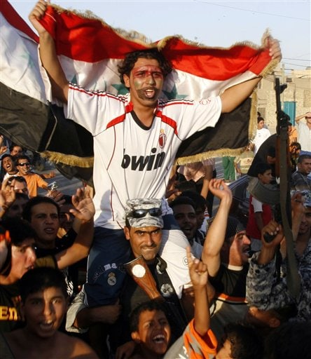 Soccer fans take to the streets of the Shiite enclave of Sadr City in Baghdad, Iraq, after the Iraq soccer team beat Saudi Arabia in the Asian Cup finals, Sunday, July 29, 2007. Iraq won the final after defeating Saudi Arabia 1-0 in the final being played in Jakarta.