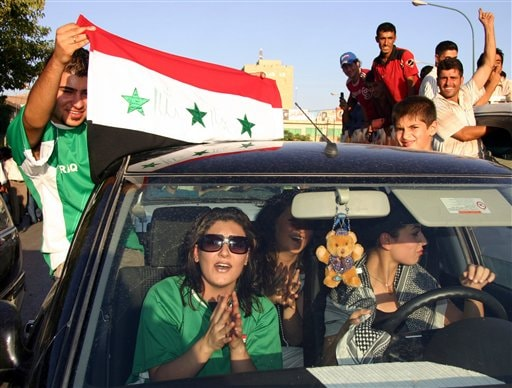 Revelers ride in a car as they take to the streets of Sulaimaniyah, 260 kilometers (160 miles) northeast of Baghdad, Iraq, to celebrate Iraq's win against Saudi Arabia in the Asian Cup soccer final Sunday, July 29, 2007. Iraq won the final after defeating Saudi Arabia 1-0 in Jakarta.