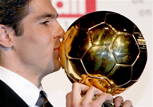 AC Milan's midfielder Ricardo Kaka, of Brazil kisses the Golden Ball after winning France's Football Player of the Year and the prestigious Golden Ball award at a photocall in Paris on Sunday, December 2, 2007. Kaka won the Golden Ball award on Sunday after helping the Italian club win the Champions League title this year with some standout performances.