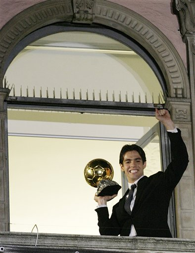 Kaka with the Golden Ball salutes from a balcony in downtown Milan's Duomo square.