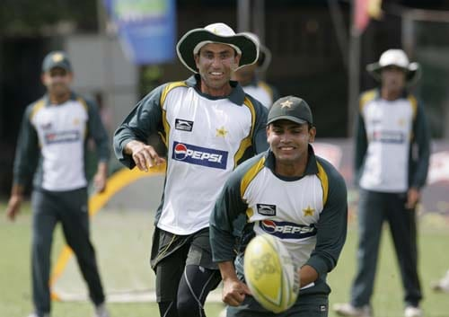 Younis Khan and Kamran Akmal run for a rugby ball during a practice session ahead of the second Test between Sri Lanka and Pakistan in Colombo. (AP Photo)