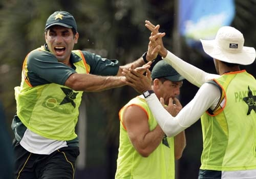 Misbah-ul-Haq celebrates with teammate Umar Gul as David Dwyer, whistles a point, during a rugby match at a practice session ahead of the second Test between Sri Lanka and Pakistan in Colombo. (AP Photo)