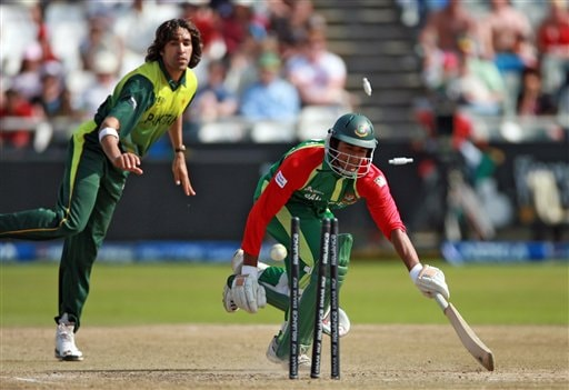 Bangladesh's Mahmud Riyad is run out by Pakistan's Umar Gul during their ICC Twenty20 Cricket World Cup match in Cape Town, South Africa, Thursday Sept. 20, 2007.