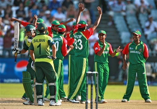 Bangladesh cricketers celebrate the wicket of Pakistan's Younis Khan, left during their ICC Twenty20 Cricket World Cup match in Cape Town, South Africa, Thursday Sept. 20, 2007.