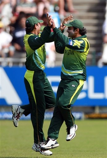 Pakistan's Younis Khan, left, and Muhammad Hafeez, right, celebrate a wicket during their ICC Twenty20 Cricket World Cup match against Bangladesh in Cape Town, South Africa, Thursday Sept. 20, 2007.