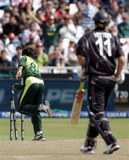 Pakistan's bowler Mohammad Hafeez, left, runs out New Zealand's batsman Daniel Vettori, right, for a duck during the semi final of the Twenty20 World Championship cricket against New Zealand at the Newlands Stadium in Cape Town, South Africa, Saturday, Sept. 22, 2007.