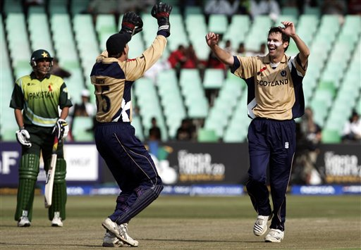Scotland's Craig Wright, right, celebrates the dismissal of Pakistan's Shahid Afridi during their Twenty20 World Championship cricket match in Durban, South Africa, Wednesday Sept. 12, 2007