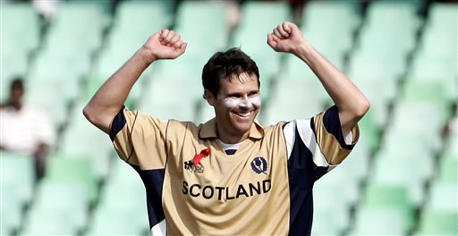 Scotland's Craig Wright celebrates the dismissal of Pakistan's Shahid Afridi during their Twenty20 World Championship cricket match in Durban, South Africa, Wednesday Sept. 12, 2007.