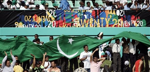 Cricket fans raise Pakistan's national flag during the Twenty20 World Championship cricket match between Pakistan and Scotland in Durban, South Africa, Wednesday Sept. 12, 2007.
