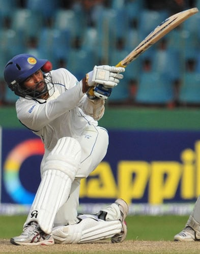 Tillakaratne Dilshan is hit in the face by the ball on the second day of the third and final Test at The Sinhalese Sports Club in Colombo. (AFP Photo)