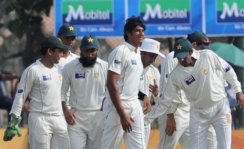 Abdur Rauf is congratulated by teammates after the dismissal of Angelo Mathews during third day of the first Test match between Pakistan and Sri Lanka at The Galle International Stadium in Galle. (AFP Photo)