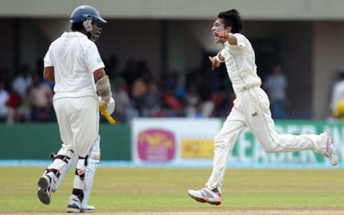 Mohammad Aamer celebrates after the dismissal of Kumar Sangakkara during the third day of the first Test match between Pakistan and Sri Lanka at The Galle International Stadium in Galle. (AFP Photo)