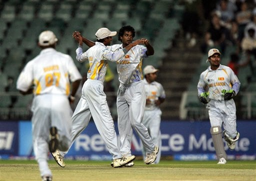 Sri Lanka's bowler Dilhara Fernando, center, celebrates with teammates after dismissing Pakistan's batsman Mohammad Hafeez, unseen, for 10 runs during their Super Eight's of their Twenty20 World Championship cricket match against Pakistan at the Wanderers Stadium in Johannesburg, South Africa, Monday, Sept. 17, 2007.