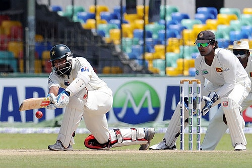 Mohammad Yousuf plays a shot as Kumar Sangakkara looks on during the third day of the third and final Test match between Sri Lanka and Pakistan at The Sinhalese Sports Club in Colombo. (AFP Photo)