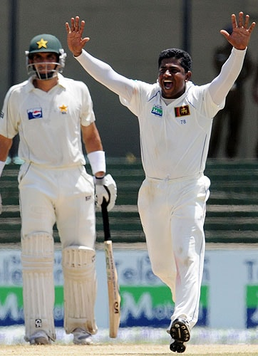 Rangana Herath celebrates the dismissal of Mohammad Yousuf during the third day of the third and final Test match between Sri Lanka and Pakistan at The Sinhalese Sports Club in Colombo. (AFP Photo)