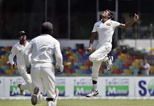 Thilan Thushara celebrates with teammates after taking a catch off his own bowling to dismiss Fawad Alam during the third day of the third Test match between Sri Lanka and Pakistan in Colombo. (AP Photo)