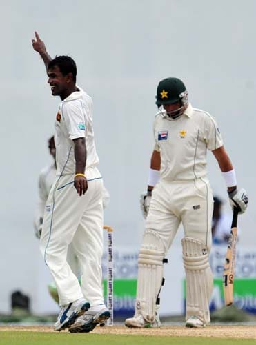 Nuwan Kulasekara celebrates the dismissal of Misbah-ul-Haq during the first day of the second Test match between Pakistan and Sri Lanka at The P. Saravanamuttu Stadium in Colombo. (AFP Photo)